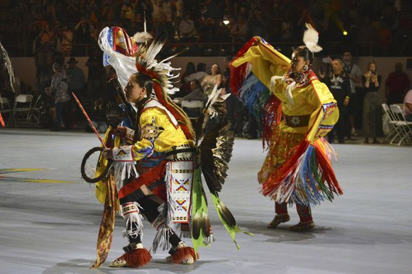 In this April 27, 2019 file photo, dancers enter at the Gathering of Nations, one of the world's largest gatherings of indigenous people in Albuquerque, N.M. A handful of states, including New Mexico and Maine, are celebrating their first Indigenous Peoples' Day as part of a trend to move away from a day honoring Christopher Columbus. (AP Photo/Russell Contreras, File)
