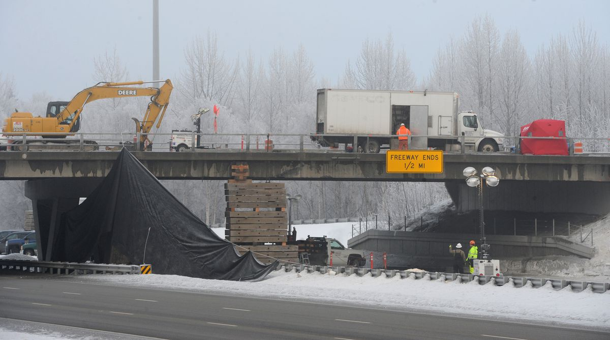 Work continues on the Tudor Road overpass on Sunday, Jan. 6, 2019. All three northbound lanes of the Seward Highway are closed to traffic at this time and are expected to reopen early in the week. (Bill Roth / ADN)