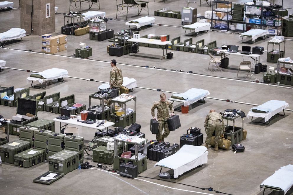 Army soldiers from Fort Carson and Fort Lewis set up the Intermediate Care Ward as they continue to set up the field hospital for non-COVID-19 patients at CenturyLink Field Events Center on Wednesday. (Amanda Snyder/Seattle Times/TNS)