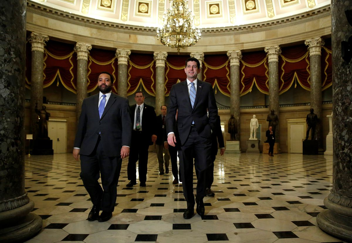 Speaker of the House Paul Ryan (R-WI) walks to the House floor before a vote to pass a budget and to end a government shutdown on Capitol Hill early Friday. REUTERS/Joshua Roberts