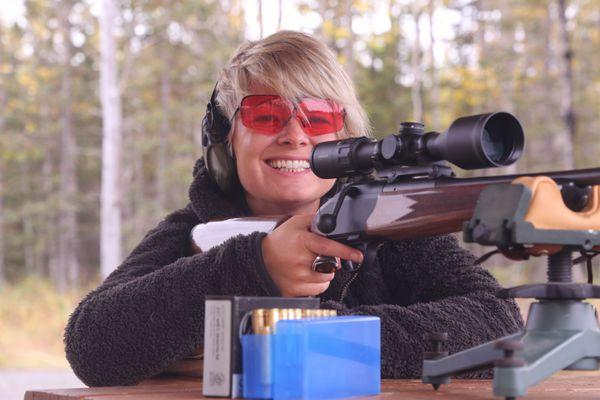 Christine Cunningham practices shooting a rifle. (Steve Meyer photo)