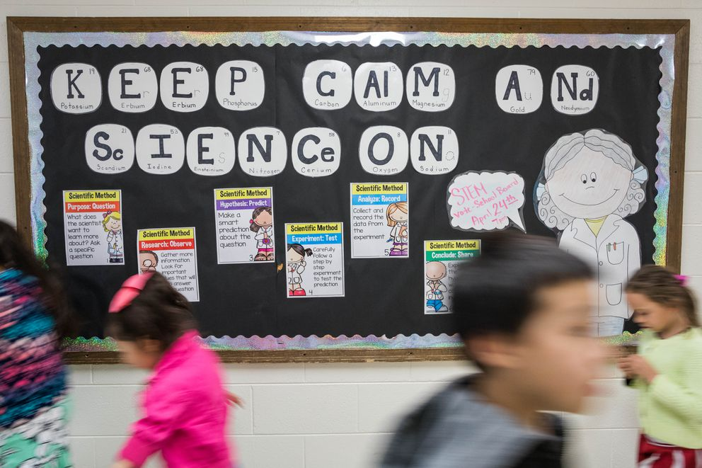 A billboard encourages the practice of science in the Campbell Elementary school hallway Friday, May 5, 2017. (Loren Holmes / Alaska Dispatch News)