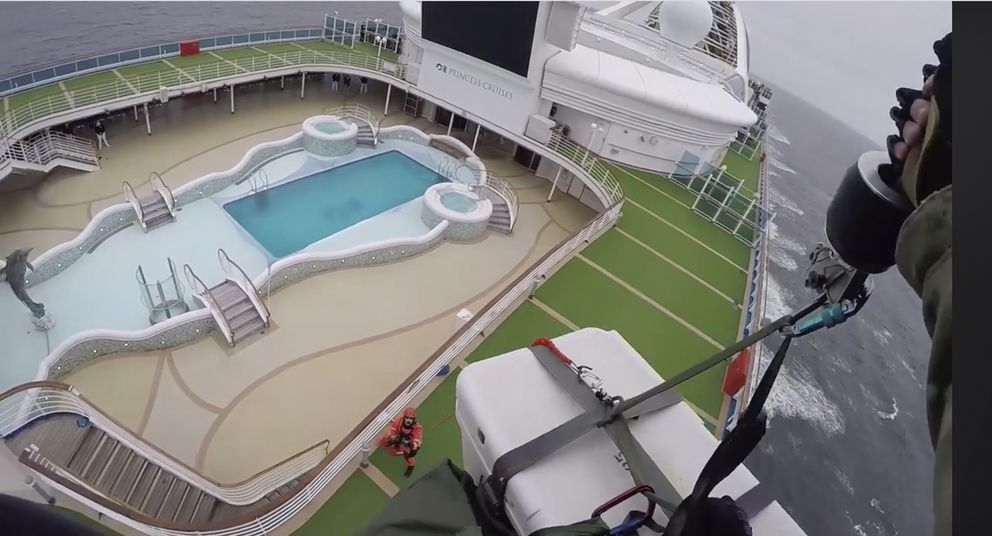 In this image from video, provided by the California National Guard, airmen with the 129th Rescue Wing drop virus testing kits down to the Grand Princess cruise ship off the coast of California Thursday, March 5, 2020. Scrambling to keep the coronavirus at bay, officials ordered a cruise ship with 3,500 people aboard to stay back from the California coast Thursday until passengers and crew can be tested, after a traveler from its previous voyage died of the disease and at least two others became infected. The California National Guard 129th Rescue Wing lowered test kits onto the 951-foot (290-meter) Grand Princess by rope as the vessel lay at anchor off Northern California, and authorities said the results would be available on Friday. Princess Cruise Lines said fewer than 100 people aboard had been identified for testing. (California National Guard via AP)