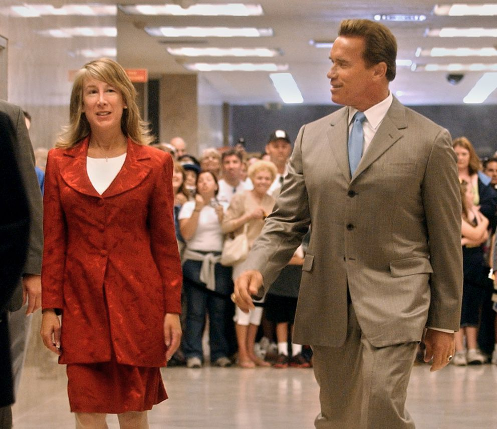 Gov. Arnold Schwarzenegger talks with finance director Donna Arduin as they walk to a Capitol news conference held in Sacramento, Calif., Tuesday, June 15, 2004. (AP Photo/Rich Pedroncelli)