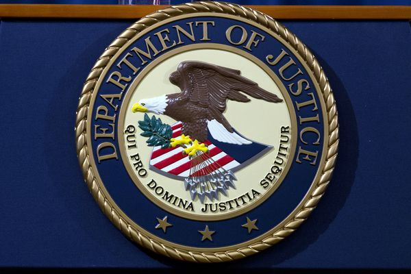 FILE - In this Nov. 28, 2018, file photo, the Department of Justice seal is seen in Washington, D.C. (AP Photo/Jose Luis Magana, File)