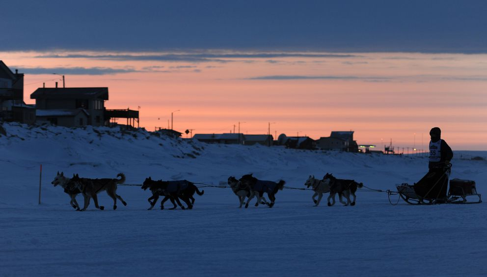 Josh Cadzow of Fort Yukon nears Nome before sunrise in 2013. (Bill Roth / ADN)