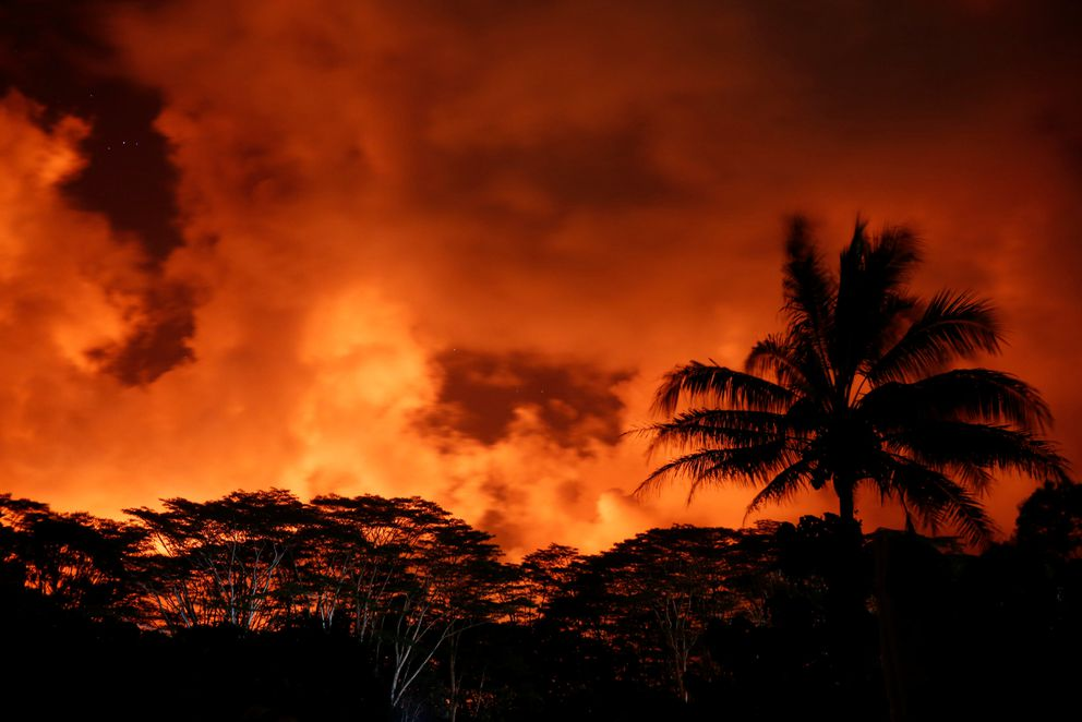 Clouds glow above a lava flow on the outskirts of Pahoa during ongoing eruptions of the Kilauea Volcano in Hawaii, U.S., May 18, 2018. REUTERS/Terray Sylvester