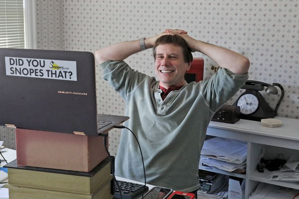 David Mikkelson, founder of Snopes, the site that tracks fakery on the web, in his home office in a nearly 100-year old home in Tacoma, Wash. on Sept. 25, 2018. (Greg Gilbert/Seattle Times/TNS)