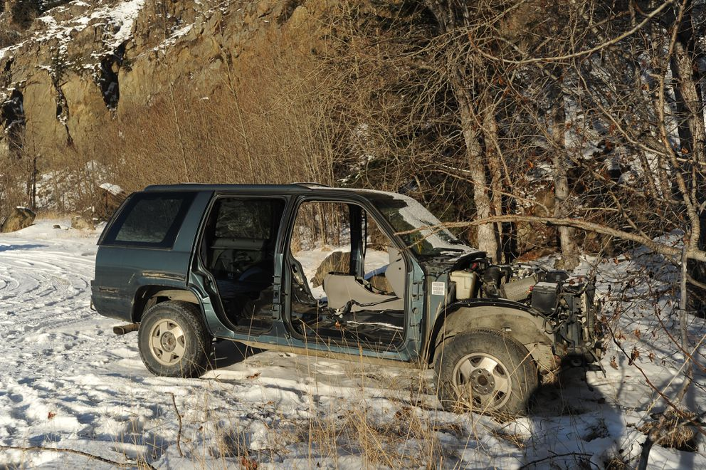 A stripped and abandoned SUV along the Seward Highway, Feb. 8, 2018. (Bob Hallinen / ADN)