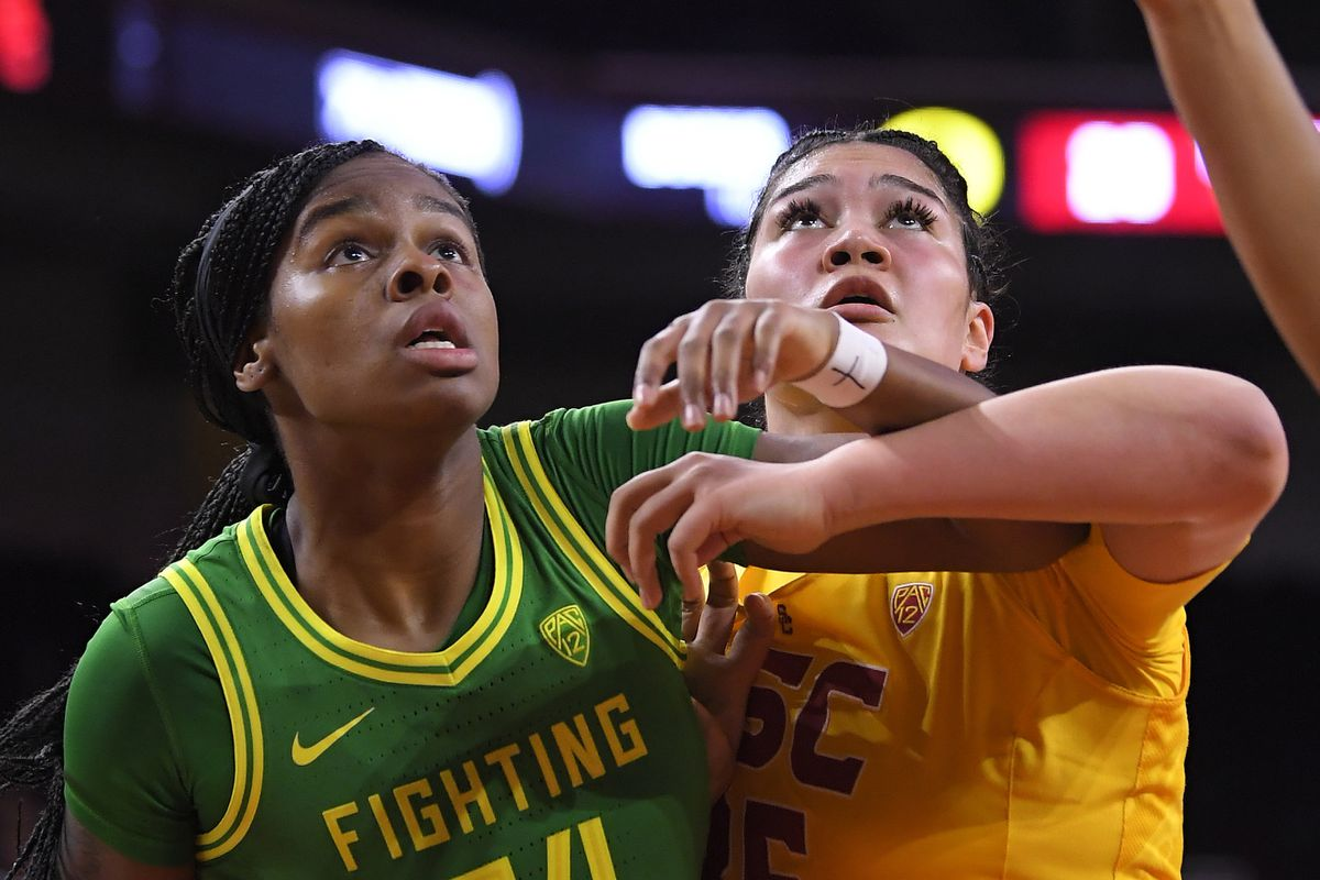 Oregon forward Ruthy Hebard of Fairbanks, left, and USC forward Alissa Pili of Anchorage look for a rebound during the first half of Sunday's Pac-12 women's basketball game in Los Angeles. (AP Photo/Mark J. Terrill)