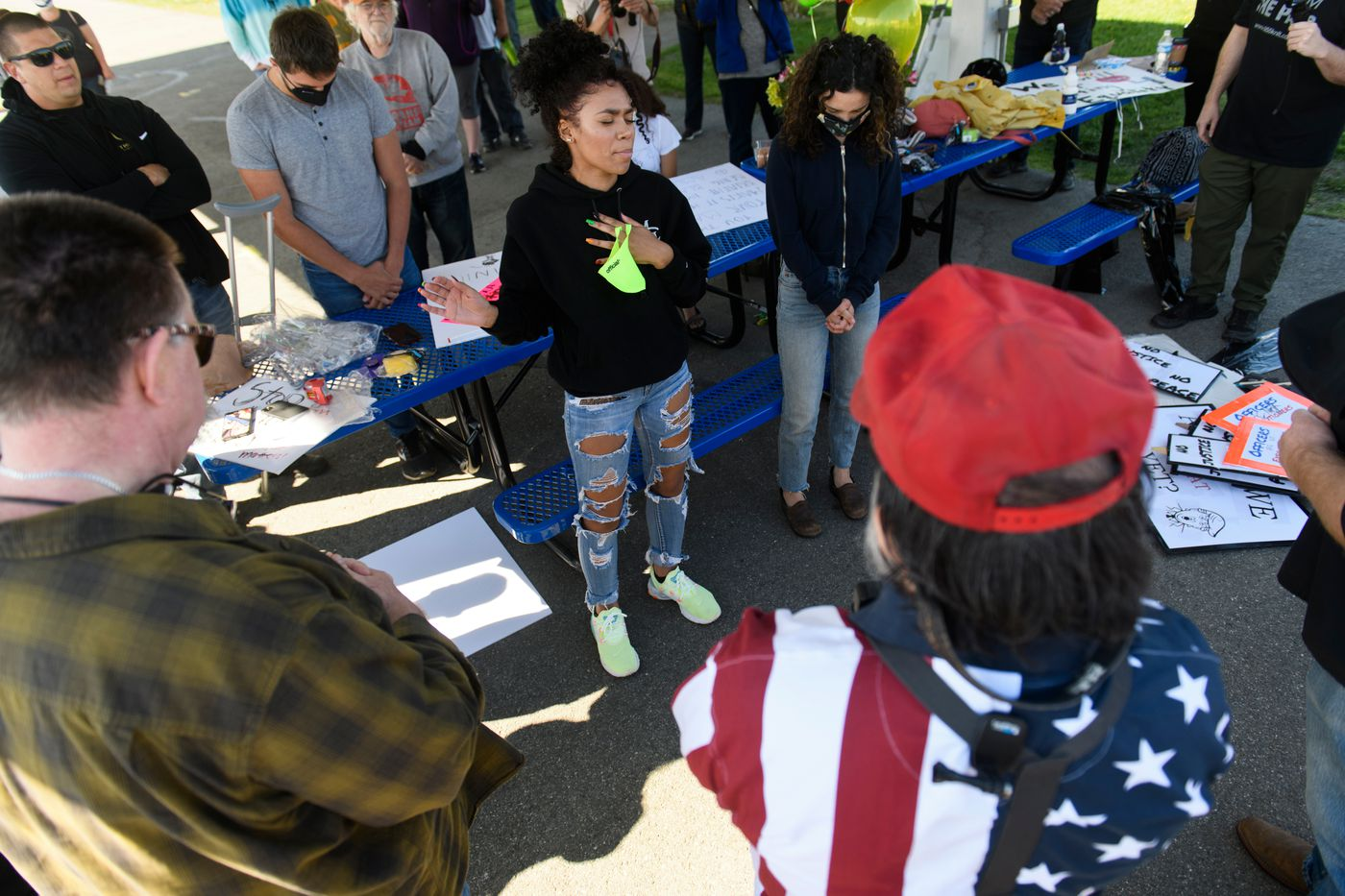 Eden Johnson leads a prayer before the event begins. A large crowd gathered and marched through Palmer to protest racism and police brutality on Saturday, June 6, 2020. (Marc Lester / ADN)