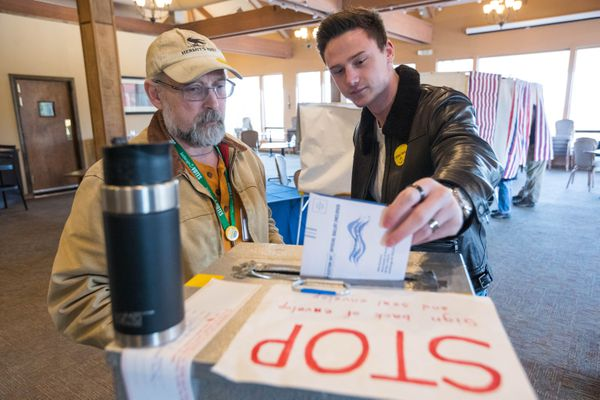 First-time voter Hunter Fanning drops his ballot in a box at an accessible vote center in O'Malley's on the Green on election day, Tuesday, April 2, 2019. At left is election worker Doug Molyneaux. (Loren Holmes / ADN)