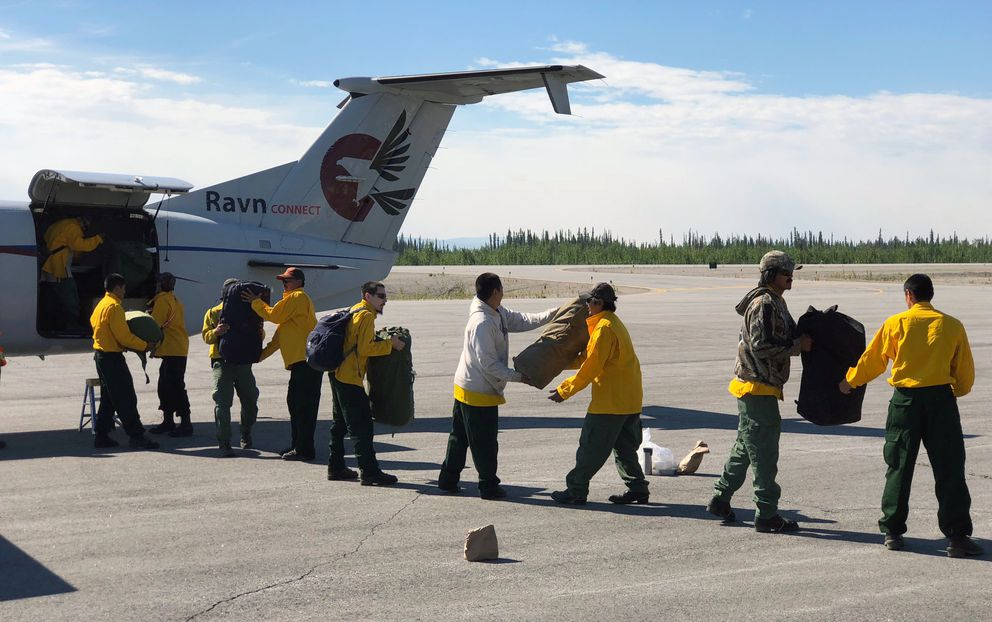 The Kobuk Valley #1 Type 2 Crew offloads their gear after arriving at the Northway Airport on Tuesday, July 31, 2018 to work on the Taixtsalda Hill Fire. (Jim Schwarber/Alaska Division of Forestry)