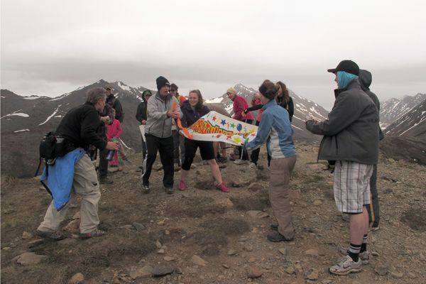 Steve Hufford and almost two dozen fellow climbers celebrate Hufford's 1,000 climb of Near Point on May 23, 2015.