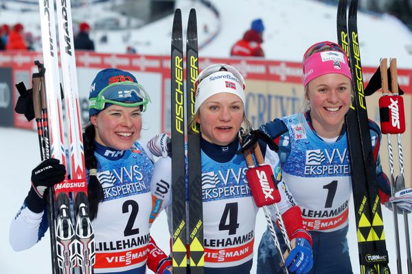 Skiing - FIS Cross Country World Cup - Women's sprint classic style - Lillehammer, Norway - December 2, 2017. First place winner Maiken Caspersen Falla of Norway, second place winner Krista Parmakoski of Finland and third place winner Sadie Bjornsen of the U.S. pose for a picture.