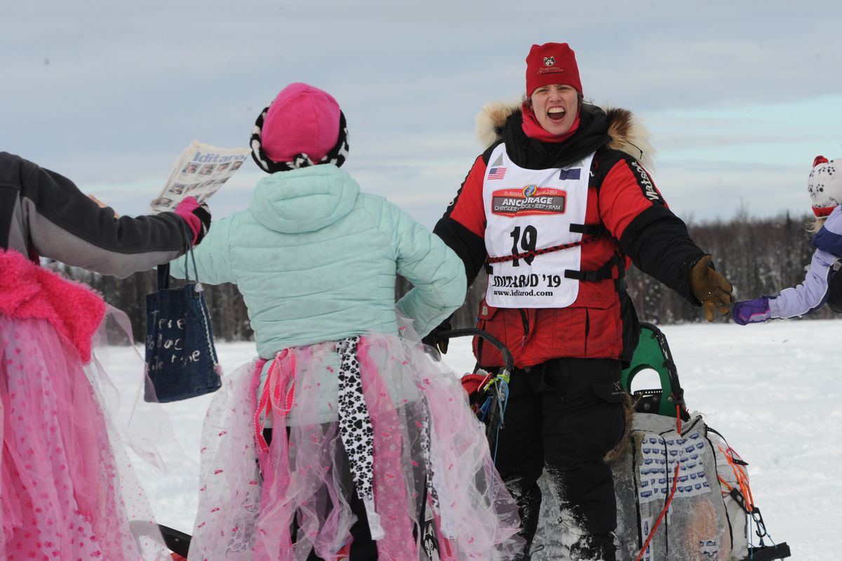 Iditarod veteran Aliy Zirkle connects with fans on Emswiler Lake during the restart of the 2019 Iditarod Trail Sled Dog Race in Willow. (Bill Roth / ADN)