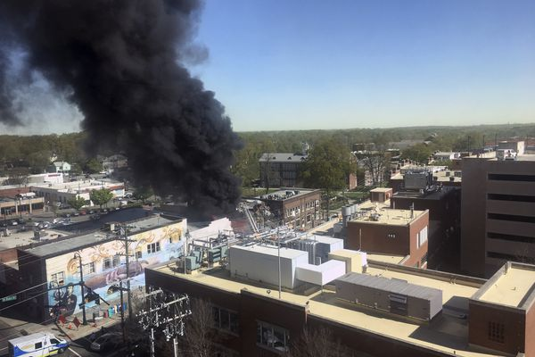 Smoke billows from the scene of an explosion and fire in downtown Durham, N.C. Wednesday, April 10, 2019. (Hanna Davison/The News & Observer via AP)