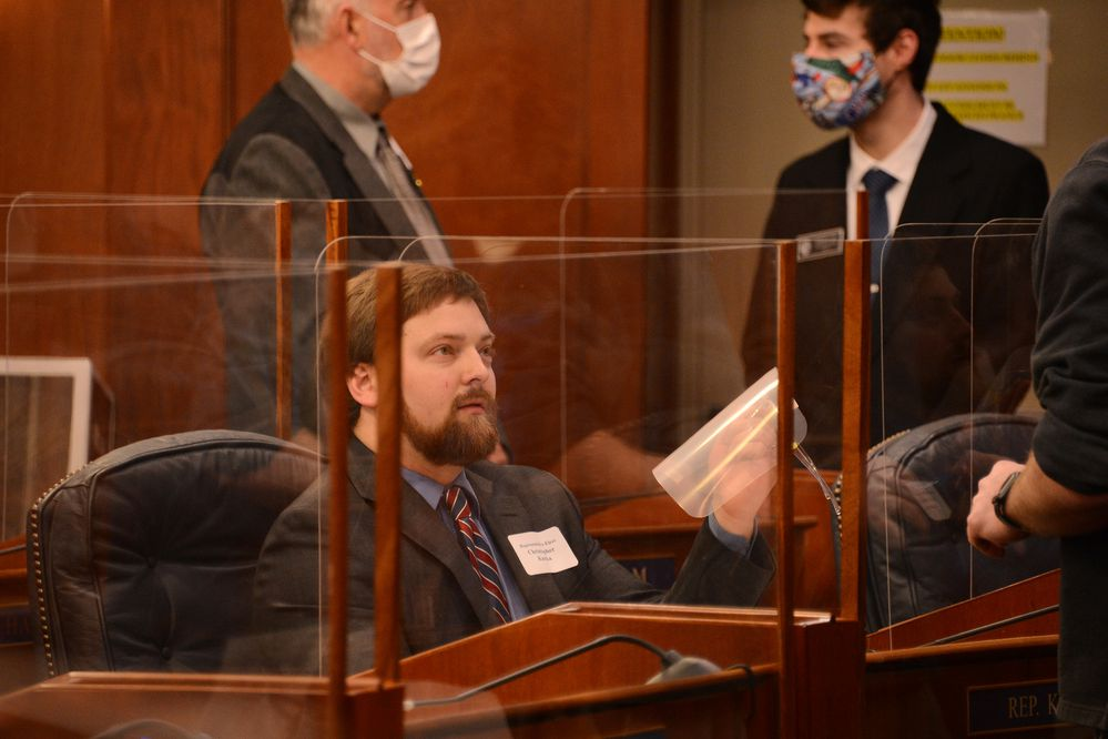 Representative-elect Christopher Kurka, R-Wasilla, reacts on Wednesday, Jan. 13, 2021 after being handed a face shield by the assistant Sergeant at Arms in the Alaska House of Representatives. Kurka, who entered the House chambers without a mask, was asked to wear the face shield during a training session for new legislators. (James Brooks / ADN)