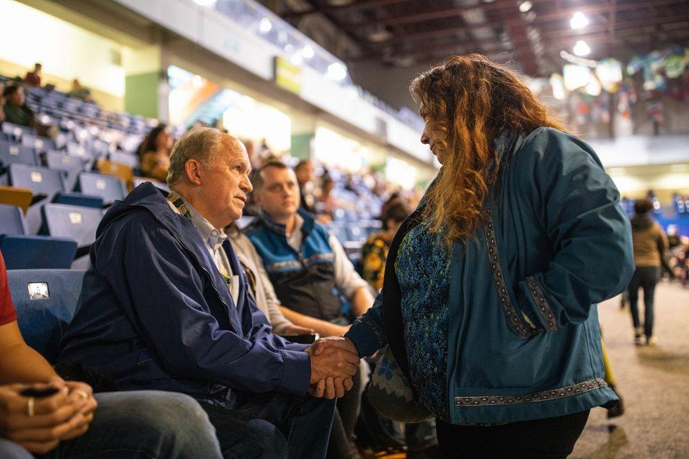 Anna Sattler greets former Alaska Gov. Bill Walker on Friday at AFN. (Loren Holmes / ADN)