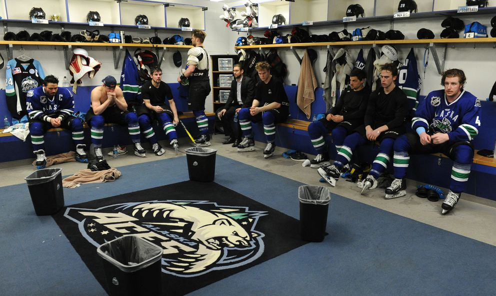The Alaska Aces sit in the locker room after their final game at the Sullivan Arena on Saturday. (Bob Hallinen / Alaska Dispatch News)