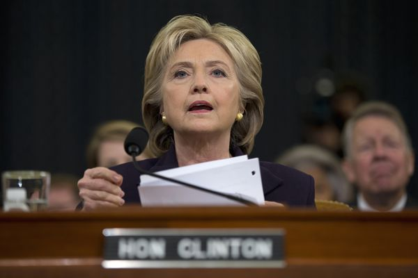 Former Secretary of State Hillary Rodham Clinton looks toward the dais as she settles into her seat on Capitol Hill in Washington on Thursday.