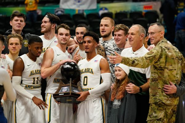 UAA holds the Armed Force Classic trophy after winning the game against Coast Guard Friday, Nov. 8, 2019 at the Alaska Airlines Center in Anchorage. (Loren Holmes / ADN)