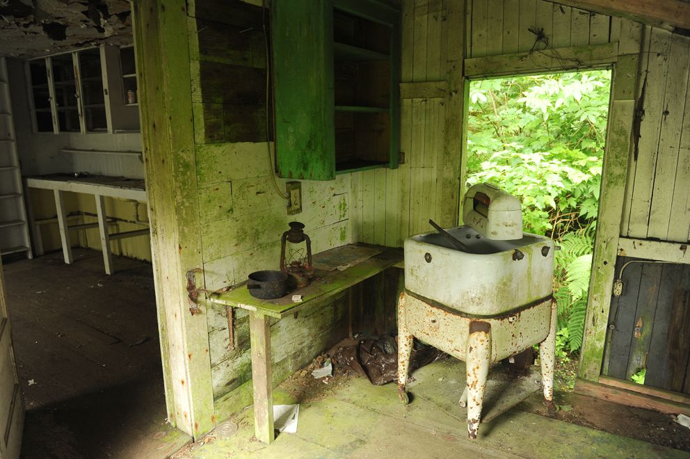 A wringer washing machine in one of the outbuildings. (Bob Hallinen / ADN)