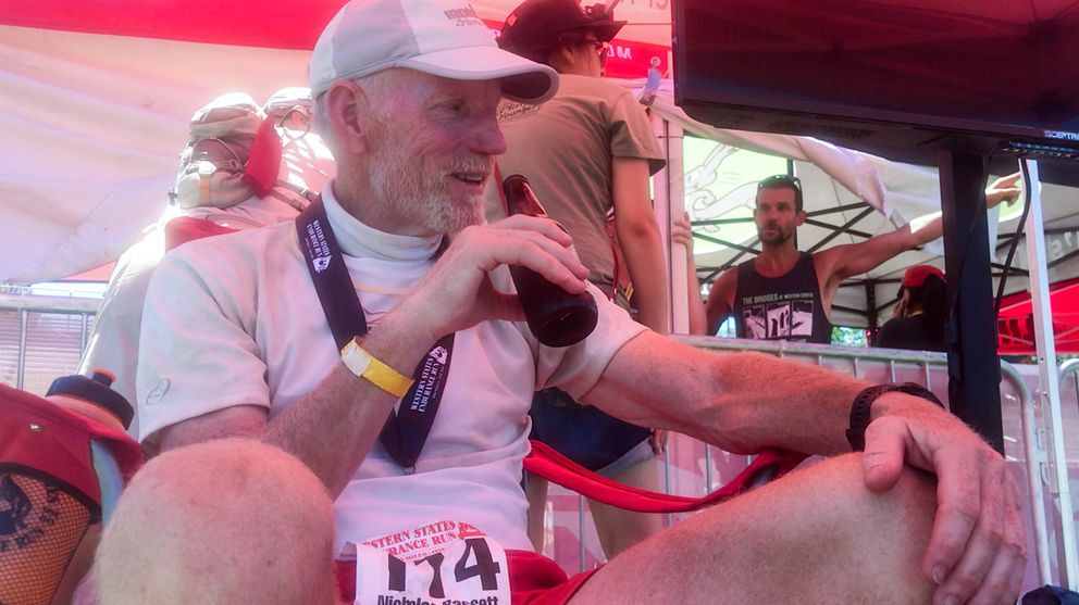 Nick Bassett sits for the first time in 29 hours after finishing the Western States 100. (Photo by Alysa Horn)