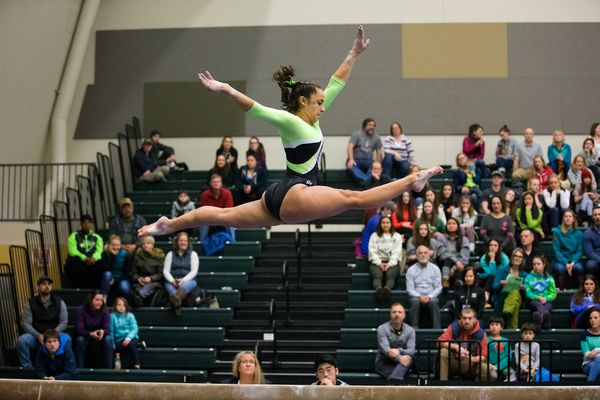 Sophia Hyderally takes to the air on the balance beam during UAA's season-opening meet on January 4, 2019, at the Alaska Airlines Center. The Seawolves registered a school-record team score and Hyderally won the balance for the second time in two seasons Saturday in the conference meet in Seattle. (Photo by Skip Hickey / UAA)