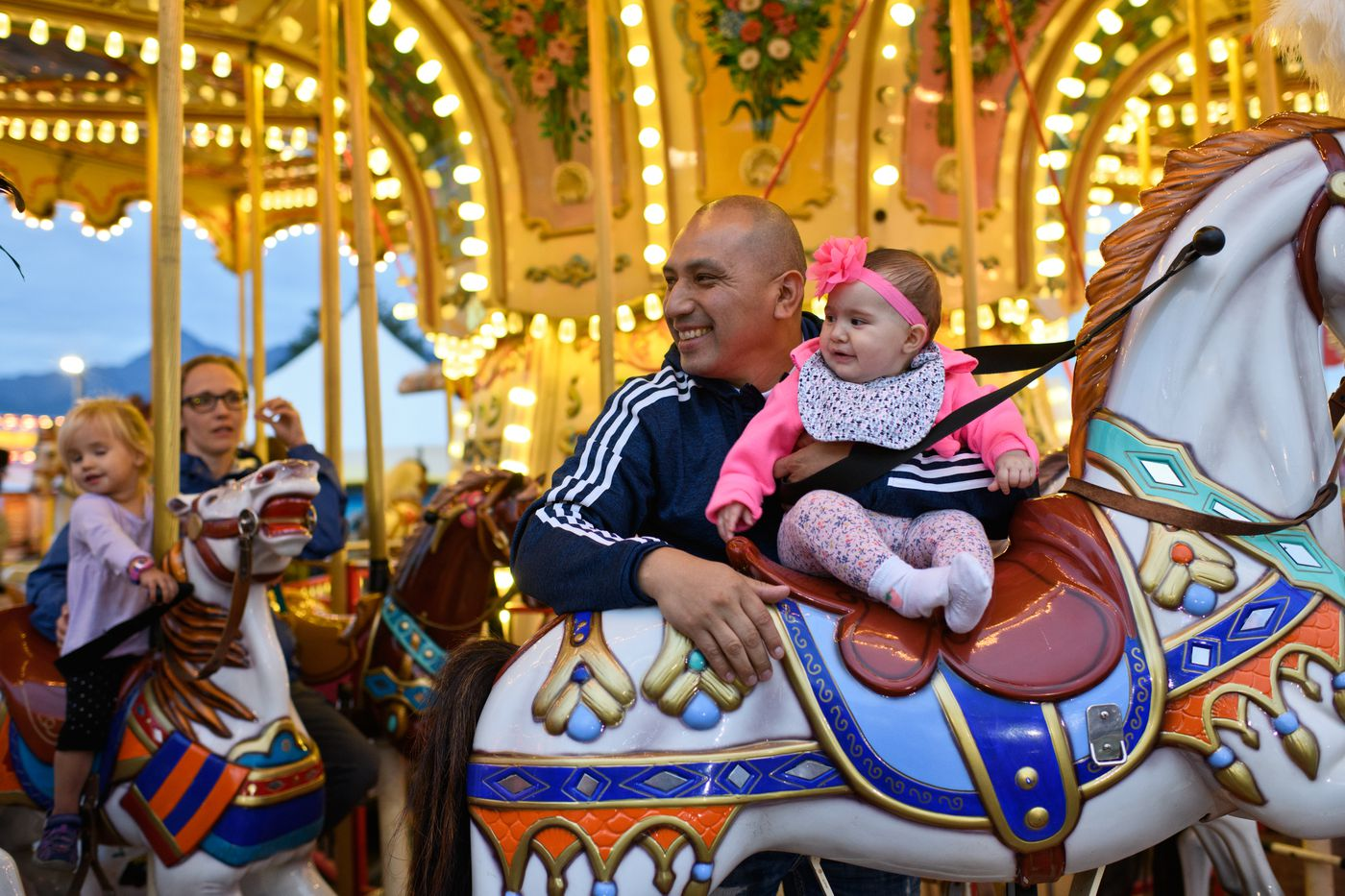 Riders enjoy the carousel at the Alaska State Fair on August 28, 2018. (Marc Lester / ADN)