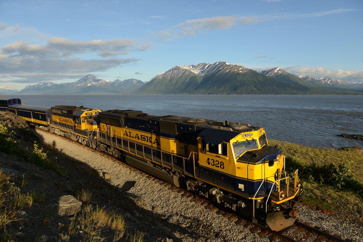 An Alaska Railroad passenger train travels along Turnagain Arm toward Anchorage on June 14, 2017. (Bob Hallinen / ADN archive)