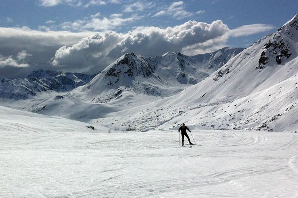 A skier skis the crust near the Fern Mine in the Talkeetna Mountains near Hatcher Pass, Monday April 30, 2012. The heavy snows of the winter combined with a healthy freeze-thaw cycle has produced a lot of crust in southcentral Alaska. Skiers, bikers and other recreationalists are enjoying the spring phenomenon. (Anne Raup / ADN)