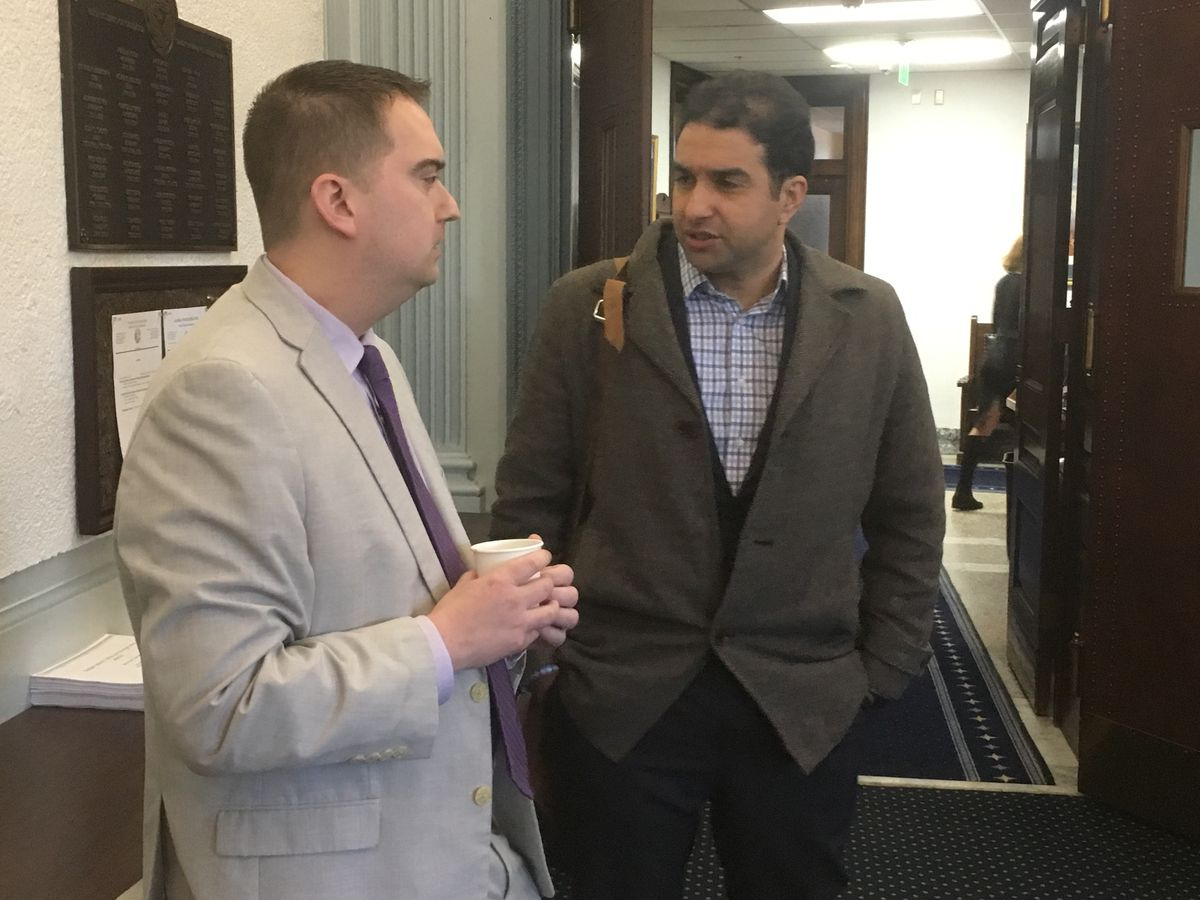 Ed King, chief economist for the Office of Management and Budget, left, talks with Mouhcine Guettabi, economist with the Institute for Social and Economic Research at the University of Alaska Anchorage, on Thursday morning, March 7, 2019 in the Alaska State Capitol. (James Brooks / ADN)