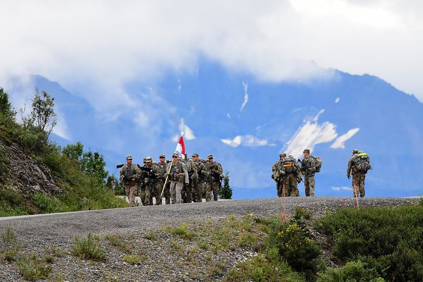 Soldiers from C Troop, 5th Squadron, 1st Cavalry Regiment, 1st Stryker Brigade Combat Team, 25th Infantry Division, march near the Savage River Bridge in Denali National Park and Preserve for Operation Denali Conquest, a 26.2-mile foot march along the park road Wednesday, July 26, 2017. (John Pennell / US Army Alaska)