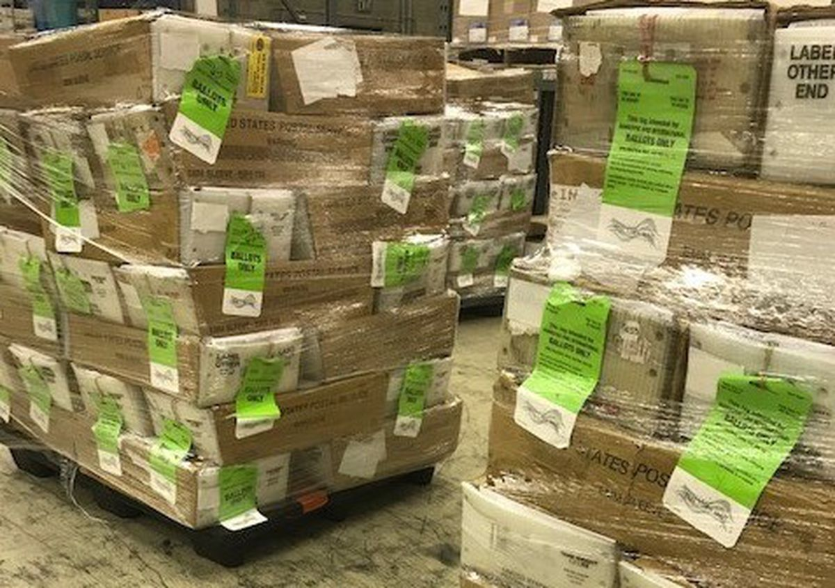 Pallets of absentee ballots are delivered to the U.S. Postal Service in Anchorage on Monday, Oct. 5, 2020. (Alaska Division of Elections photo)