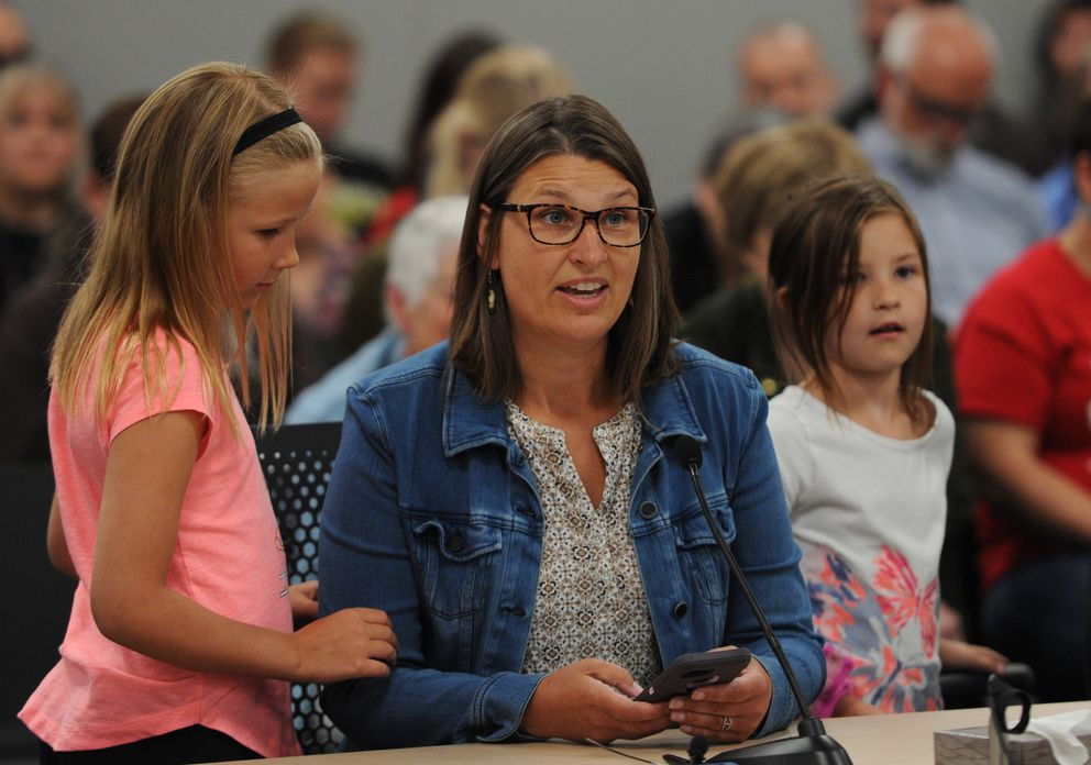 Molly Hayes was joined by her daughters Adele, 8, left, and Greta, 6, as she testified in support for a smaller PFD and reinstating the items vetoed while speaking at the Alaska House Finance Committee meeting in Anchorage on Monday, July 15, 2019. (Bill Roth / ADN)