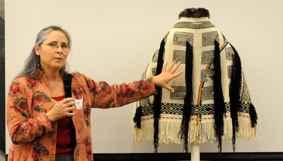Sitka weaver Teri Rofkar discusses a healing robe at the Alaska Native Artists Summit on Jan. 29, 2009, in Anchorage. Rofkar, renowned for her weaving skills, passed away on Friday. (Erik Hill / ADN archive)