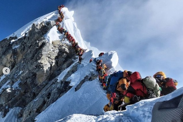 Nirmal Purja wrote in an Instagram caption that he estimated there were around 320 people in line on this steep stretch of the route to the summit of Mount Everest. (Nirmal Purja, @nimsdai on Instagram)