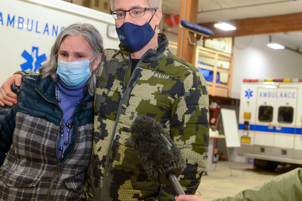 Haines Borough Mayor Doug Olerud embraces interim city manager Alekka Fullerton as they talk about David Simmons and Jenae Larson, the two people missing after a major landslide, during a press conference on Friday, Dec. 4, 2020 in the Haines fire hall. (James Brooks / ADN)