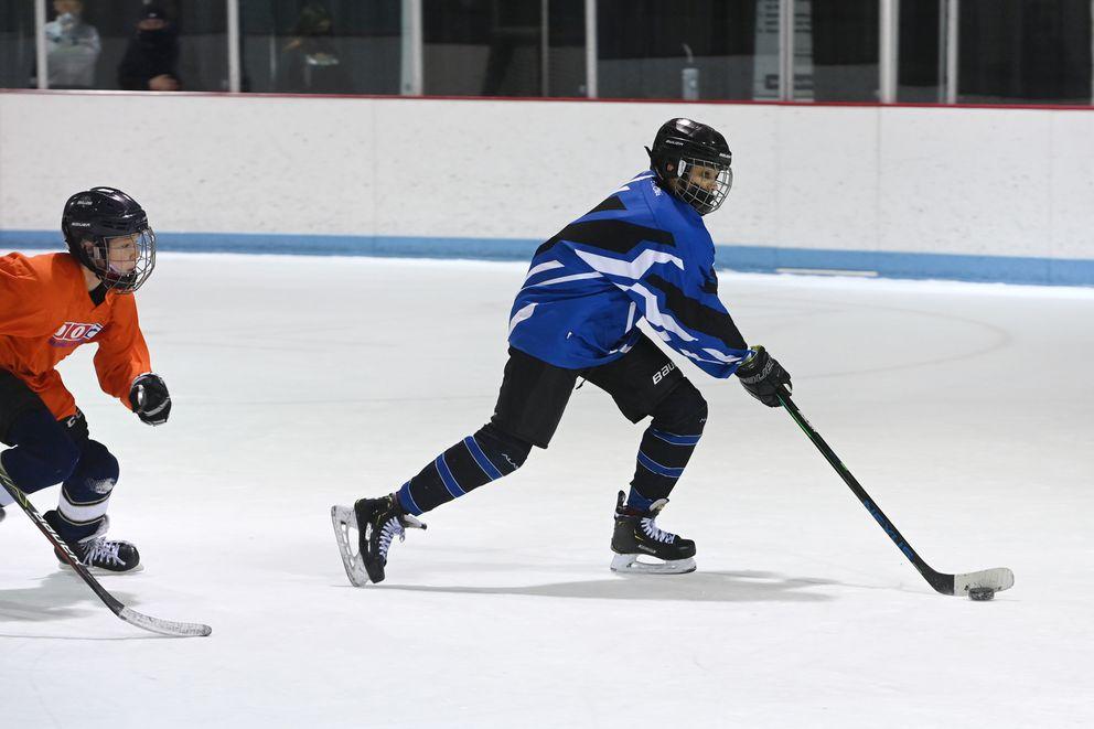Tavian Mukaabya skates with the puck Sunday at Dempsey Anderson. (Bill Roth / ADN)