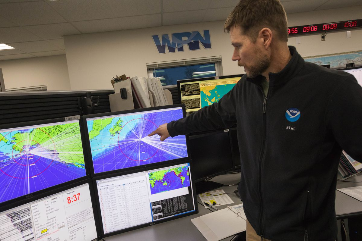 Ken Macpherson, a watchstander at the National Tsunami Warning Center in Palmer, shows a display showing the magnitude 7.9 earthquake Tuesday morning. Macpherson was working overnight when the earthquake occurred at 12:31 a.m. (Loren Holmes / ADN)