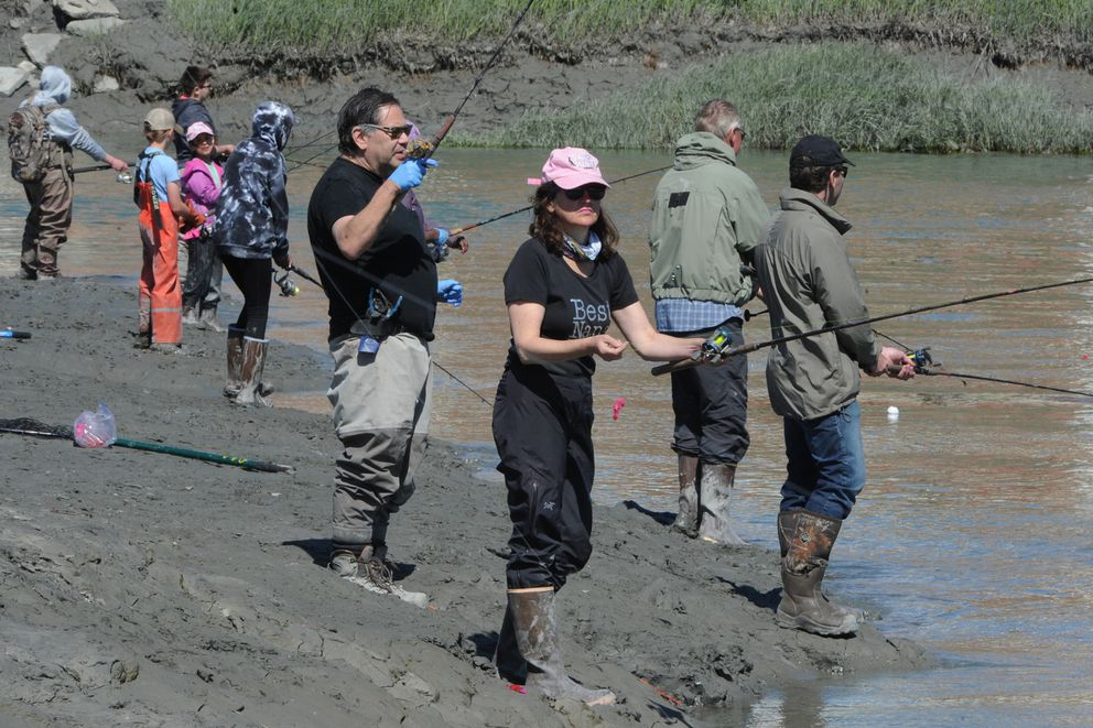 2015 Slam'n Salm'n Derby winner Maria Robinson drifts eggs beneath a bobber while fishing for king salmon at Ship Creek near downtown Anchorage on Sunday. Robinson said her favorite time to fish is half an hour after high tide. (Bill Roth / ADN)