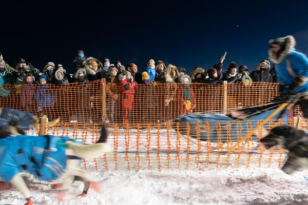 Sled dog racing fans gather on the frozen Kuskokwim River in front of Bethel to cheer on mushers racing the Bogus Creek 150 and Kuskokwim 300 sled dog races on January 17, 2020 in Bethel, Alaska. (Photo by Katie Basile / KYUK Public Media)