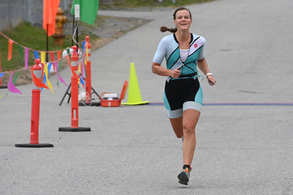 Stephanie Arnold nears the finish line on her way to a second straight victory in Sunday's Gold Nugget Triathlon at Chugiak High School. (Bill Roth / ADN)