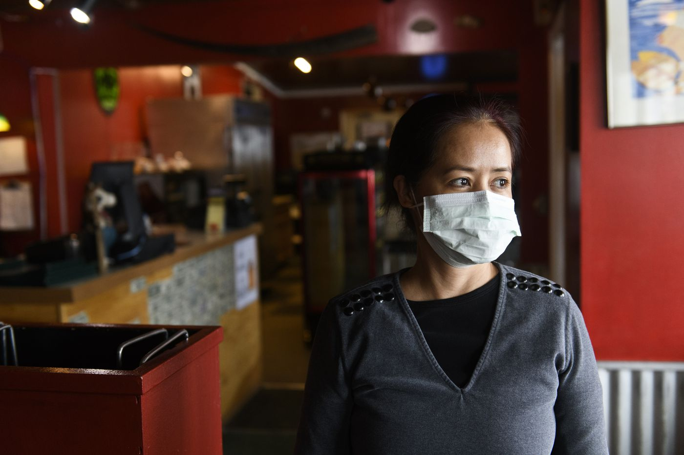 "MARCH 16. Jelma Chang said she started wearing a mask while working at Airport Pizza, a Nome restaurant, to be cautious about coronavirus. Some customer may still come to Nome to see the Iditarod finish, despite the warnings, she said. ""I don't know what state they came from, what country they came from, ' she said. (Marc Lester / ADN)"