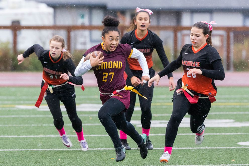 Dimond's Skylar Coleman runs the ball during the state flag football championship against West Saturday. (Loren Holmes / ADN)
