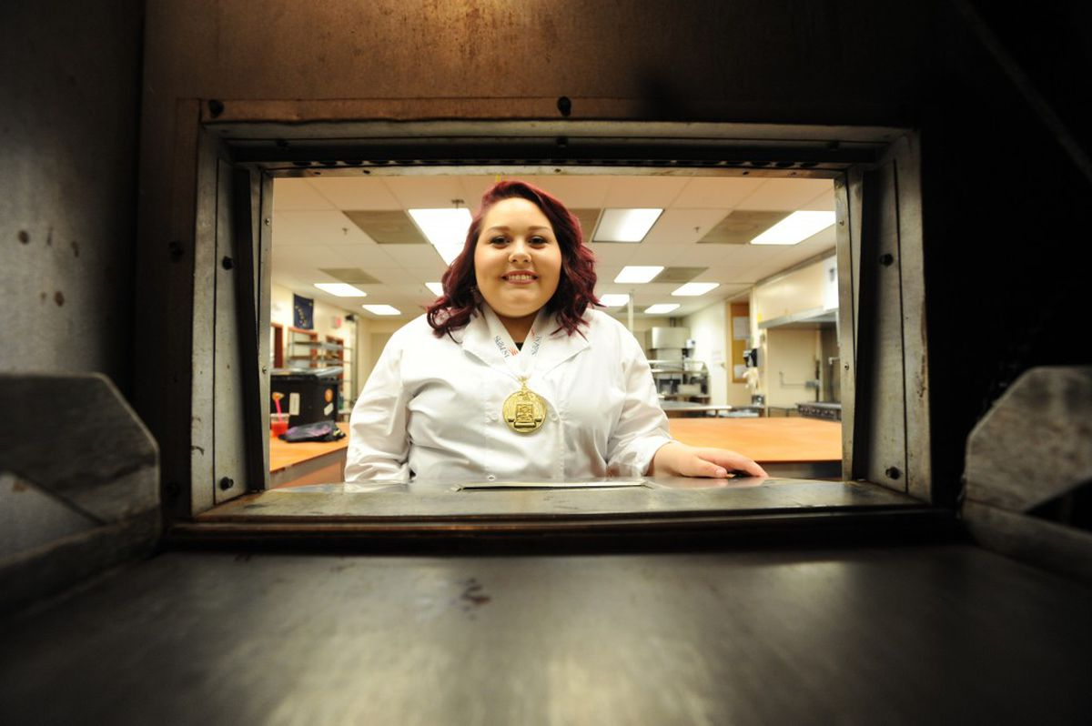 An oven frames King Career Center alumna Jordyn Baker, who claimed top honors in commercial baking at the SkillsUSA Championships this past summer in Louisville, Kentucky. (Erik Hill / Alaska Dispatch News)