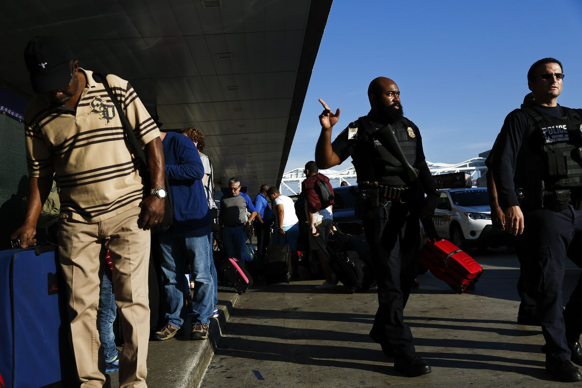 U.S. Customs and Border Protection agents monitor the Fort Lauderdale-Hollywood International Airport in Fort Lauderdale, Fla.,on Saturday. OnFriday, a gunman, identified as Esteban Santiago, opened fire at the airport, killing five people and injuring eight. (Scott McIntyre/The New York Times)