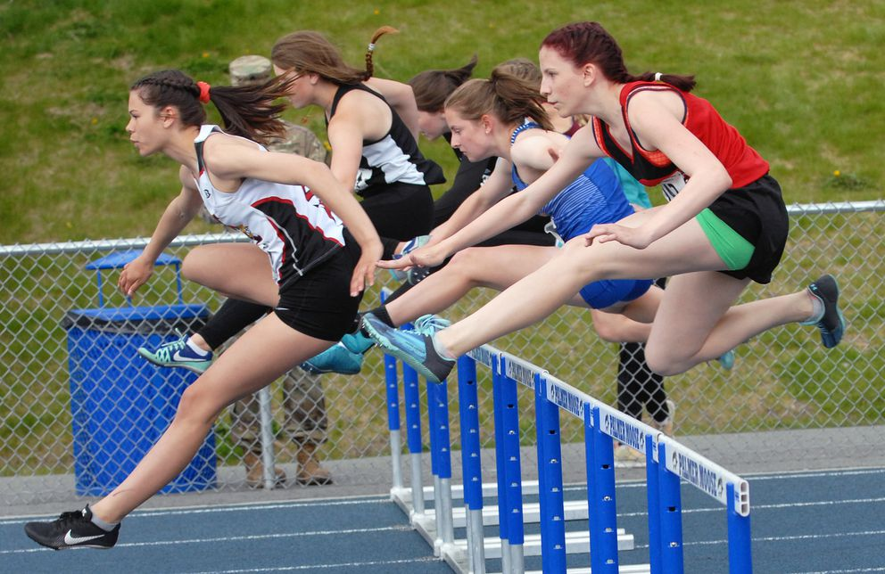 Division II girls clear their first hurdle in the 100-meter hurdles race Friday at the ASAA/First National Bank track and field championships at Machetanz Field in Palmer. (Matt Tunseth / Chugiak-Eagle River Star)