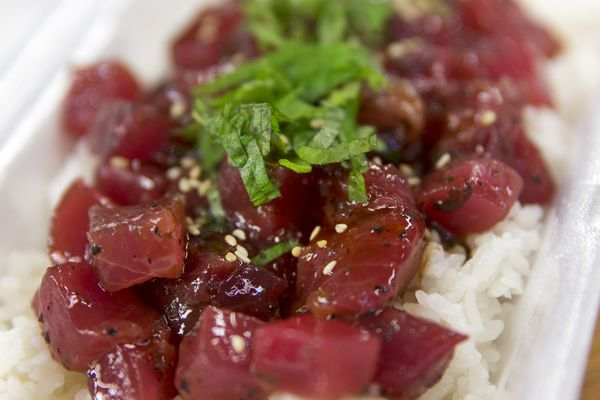 Ume-shiso ahi poke on a bed of rice at Maguro Brothers, in Chinatown's Kekaulike Market, Honolulu, Dec. 28, 2017. Poke wouldn't exist without the Hawaiian Islands' meld of cultures and reverence for the ocean, passed down by the ancients. To learn the history of the dish is to begin to understand a way of life. (Marco Garcia/The New York Times)